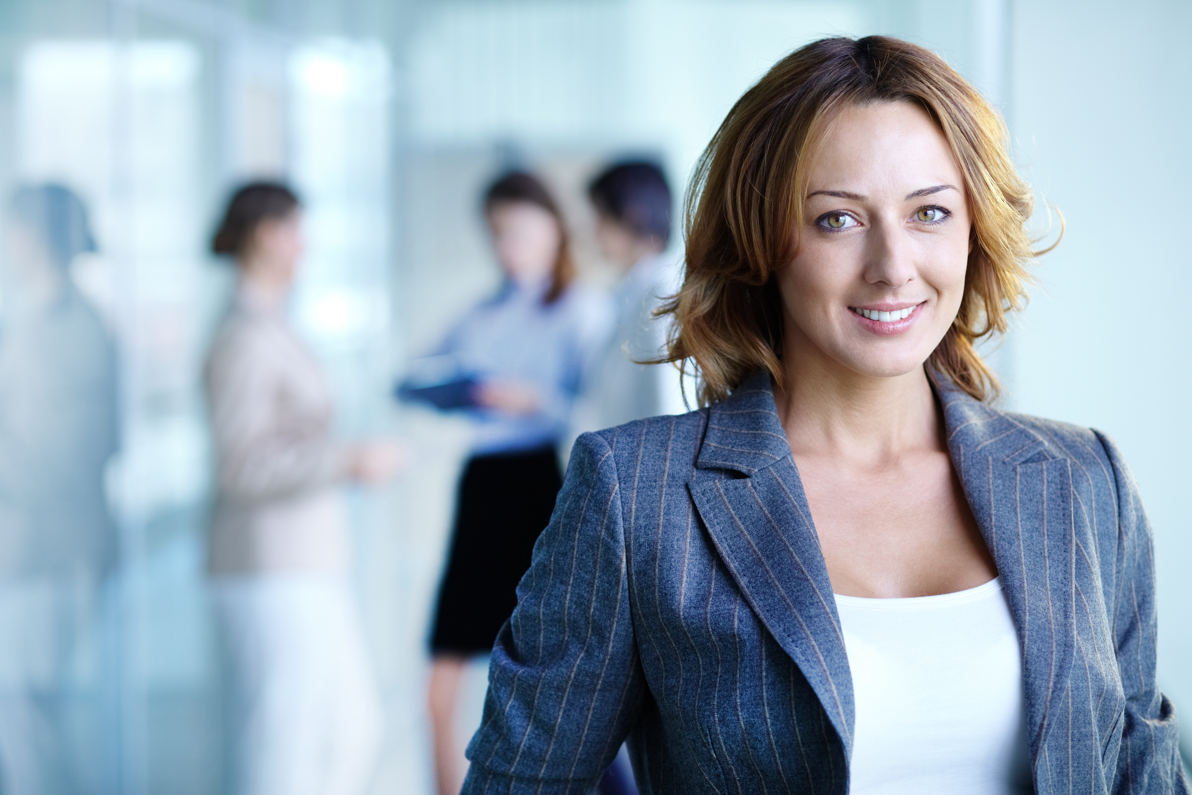 Charming business woman - Image of pretty business woman looking at camera