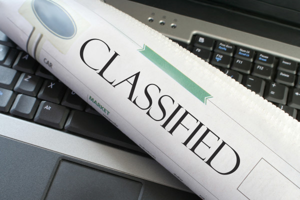 Classified Ads - Classified headline section of the newspaper on a laptop computer.